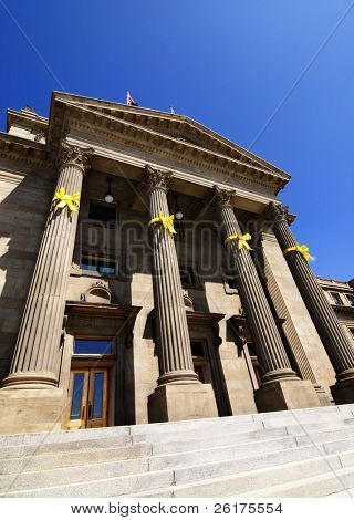Old Courthouse Building with Columns and Yellow Ribbons