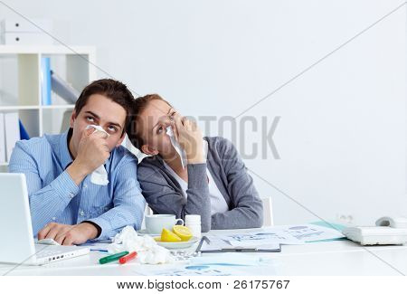 Image of sick business partners with rhinitis sitting in office