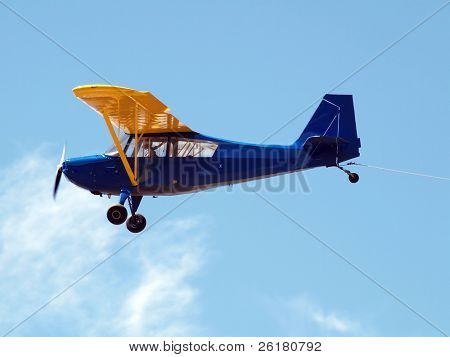 Piper Cub glider tow plane with rope connected