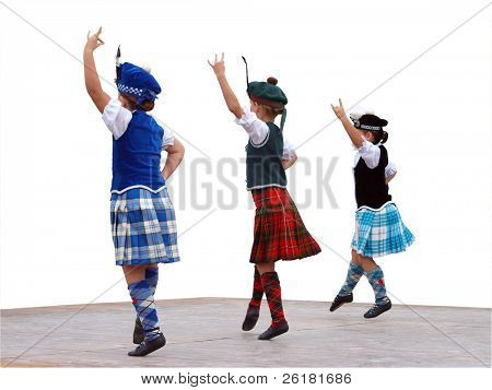 Three highland dancers on stage isolated with clipping path