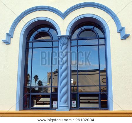 Art Deco Buildings reflected in an art deco window