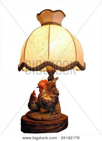 Antique lamp with ornate base isolated with clipping path
