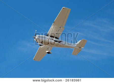 Small Aeroplane with flaps down coming in to land