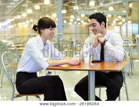 young business people  resting  in cafeteria