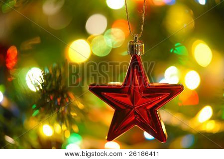 background  of inside decorated Christmas fir tree with colorful lights