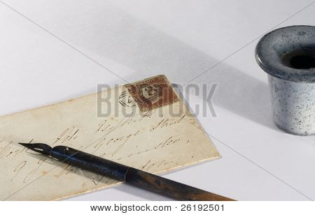 A British Victorian letter, from the 1850s, with a pen and inkpot.