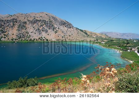 The amazing colours of Lake Kournas, Crete's only natural, permanent, fresh-water lake. The sea at Georgopolis and the Drapano Peninsula can be seen on the right.