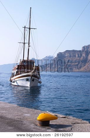 A schooner in the caldera at Santorini, Greece. Two or three such boats are used for pleasure trips around the caldera to the volcanic dome .