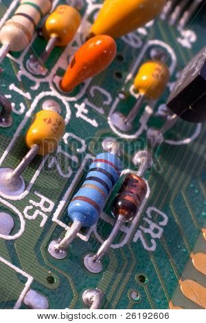 Components on a circuitboard from a 1989 286-model computer. Macro.