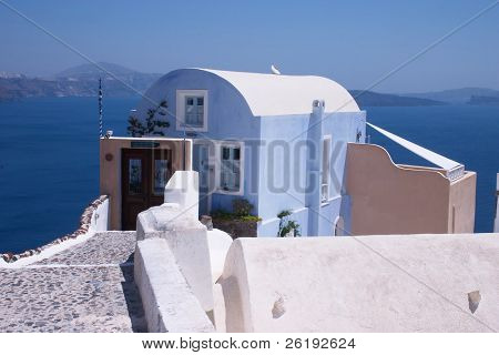 A blue house on a crag overlooking the caldera at Oia (Ia) on Santorini.