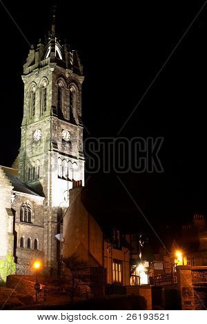 Church, or kirk,  and old pub in Peebles, Scotland, at night.