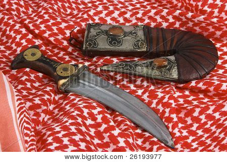 A traditional Arab dagger or khanjar on a keffiyah headdress