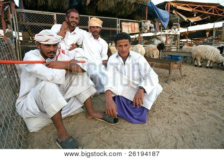 Shepherds at the municipal livestock market in Doha, Qatar. No model release, editorial only.