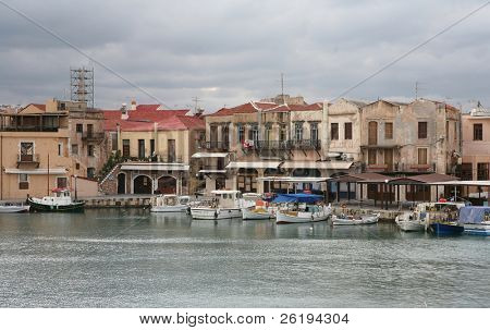The venetian harbour at Rethymno, Crete. Taverna signs are visible at maximum size. Intended for editorial use only unless all signs are removed.