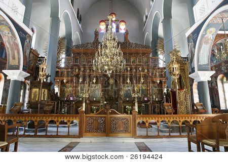 The Greek Orthodox Cathedral in Rethymno, Crete, showing the iconostasis, candelabra and some of the remarkable devotional paintings.