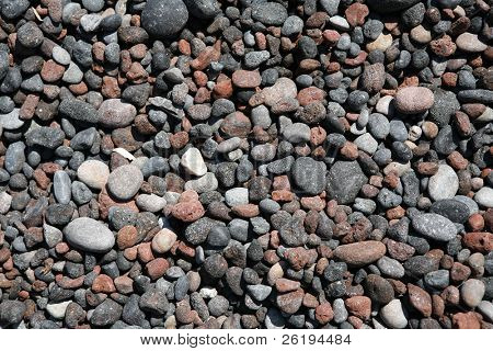 An assortment of tephra and pyroclastic pebbles on Red Beach, Santorini, I think I can make out tuffs, scoria,  rhyolite and basalt, and possibly obsidian.