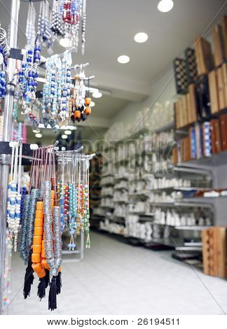 A gift shop in Crete, Greece, selling worry (or prayer) beads, chess or backgammon boards and novelty items. Shallow focus on the beads at the left.