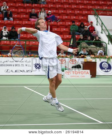 Younes El Aynoui of Morocco  in his Jan 2, 2007, Qatar Open first round win against Thomas Johansson of Sweden