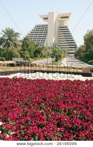 The Doha Sheraton hotel, in Qatar, seen across the flowerbeds at the end of its entry road (Feb 2007).