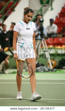 Indian tennis star Sania Mirza reflects on a lost point in the first round of the Qatar Open ATP tournament, February 26, 2007.