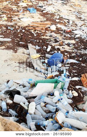 Rubbish washed up on the shore in the Arabian Gulf. Mineral water bottles, shampoo bottles and old tins are among the hazards facing marine wildlife despite regulations controlling dumping.