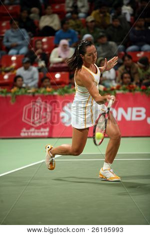 Serb tennis star Jelena Jankovic in action against Justin Henin in the Qatar Total Open, in Doha, March 2, 2007.