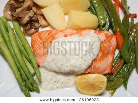 Grilled salmon steak with asparagus, fried mushrooms, stir-fried veg, boiled potatoes and a lemon wedge.
