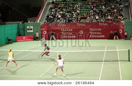 Elena Likhovtseva and Vera Dushevina (foreground) playing doubles against Venus Williams and Caroline Wozniacki in Doha, Qatar, February 2008