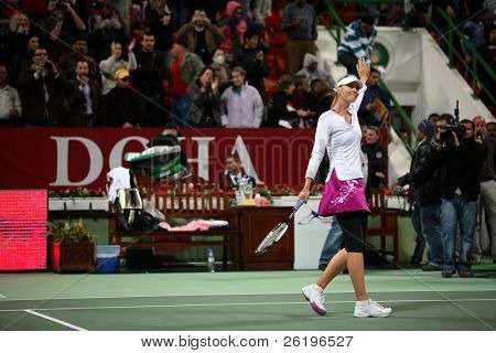 Russian tennis superstar Maria Sharapova waves to fans after her victory in the semi-final of the Qatar Total Open 2008. She went on to win the tournament for the second time.