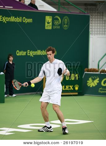 DOHA, QATAR - JAN. 6, 2009: British tennis star Andy Murray in action at the Qatar Open, in his first round match against Montanes. The match took place Jan. 6, 2009 in Doha, Qatar.
