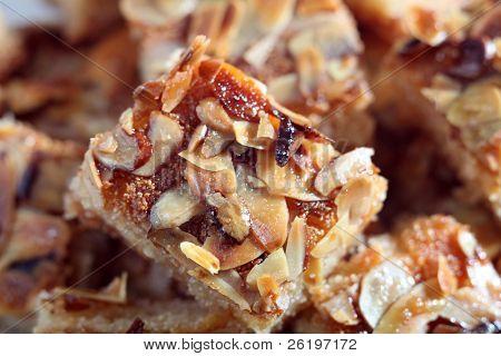 Lebanese nammora honey and semolina cake, topped with roasted almond slices