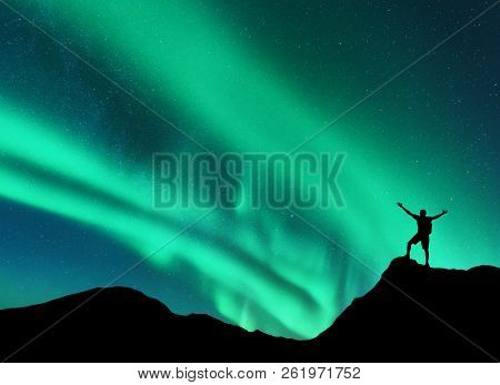 Northern Lights And Silhouette Of