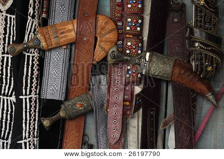Traditional Arabian khanjar daggers and belts on sale in Souq Waqif, Doha, Qatar.