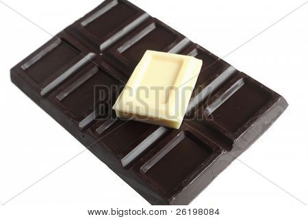 A square of white cooking chocolate on a block of dark chocolate over a white background, either for baking or symbolising variety
