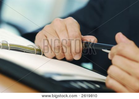 A Businessman With Pen Doing Gesticulation