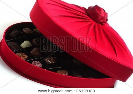 A heart-shaped box full of luxury chocolates.