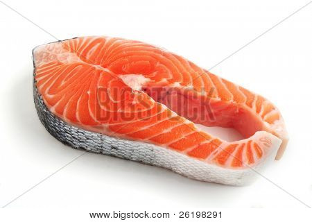 A salmon steak on a white background with a light shadow