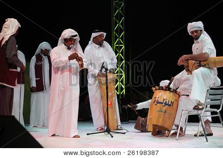 DOHA, QATAR - JANUARY 8: A Qatari folk troupe performs at a cultural event in Doha, Qatar, January 8, 2011, marking the Asian Cup football being hosted in the Gulf emirate.