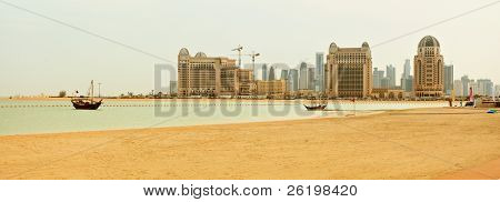 A panoramic winter view across Katara Beach, West Bay, Qatar, towards the Doha skyline, during one of the few cloudy winter days.