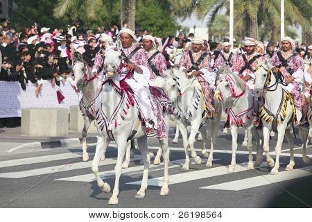 DOHA, QATAR - December 18:  Qatari mounted guardsmen in traditional attire take part in the National Day parade on the Corniche in Doha, Qatar on December 18, 2009.