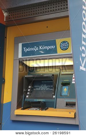 HERAKLION, GREECE - JULY 27: A Bank of Cyprus ATM in Iraklio, Crete. In June 2011 the Bank of Cyprus's part of Greek State debt was 2billion euros. July 27, 2010 in Heraklion, Crete, Greece