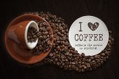 Coffee Cup And Coffee Beans On Table. Roasted Coffee Beans. Top View. Coffee Lovers. poster