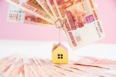 Model Of The House Standing On Five Thousand Banknotes.rental Estate.sale Property Template.model Of poster