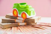 Toy Car Model And Money, Russian Money. Car Expenses Concept.the Model Of The Car On The Background  poster