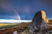 Rainbow At Drake Stone, Above Harbottle In Northumberland Which Is A Huge 30 Feet Tall Sandstone Bou poster