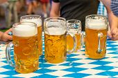 Close-up Of Bavarian Beer Glasses 1 Liter Beer On Table Decoation At The Octoberfest poster