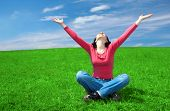 picture of hands up  - woman in field hold hand palm up under blue sky and clouds - JPG
