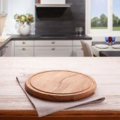 Empty Wooden Table With Pizza Board And Tablecloth Near The Window In Kitchen. White Napkin Close Up poster