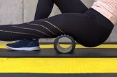 Close Up View Of Woman Exercising With Foam Roller At Gym poster