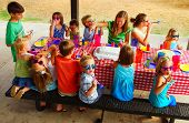 foto of birthday party  - Kids at an outdoor birthday party and picnic - JPG
